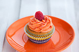 Delicious cream and raspberry cupcake