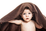 cute baby boy covered with towel isolated
