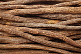 Liquorice root pieces background