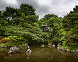 Heron sitting on the rock in the Pondin, Maruyama Park, Kyoto, J