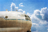 Military transport plane, blue sky background