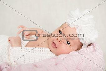 Portrait of newborn baby girl  with white headband