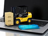 Laptop with Forklift truck. Delivering packages