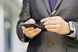 Business Man Typing With Pen On  Smartphone