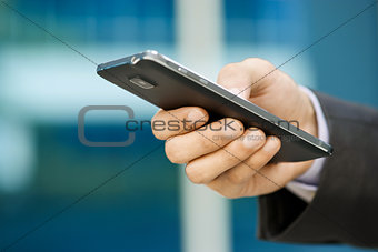 Business Man Typing With Finger On Phablet Smartphone
