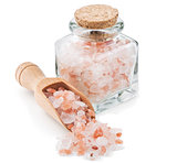 Himalayan pink salt in a glass bottle