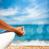 Yoga Hand on Sea Background