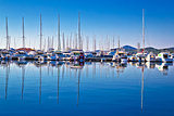 Sailboats and yachts in harbor reflections view