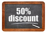 fifty percent discount blackboard sign