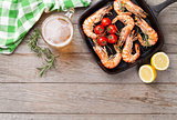 Grilled shrimps and beer