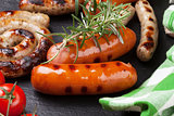 Grilled sausages with rosemary and tomatoes