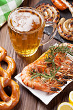 Beer mug, grilled shrimps, sausages and pretzel