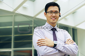 Business Man With Smartwatch And Bluetooth Handsfree Device
