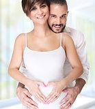 Happy couple enjoying pregnancy