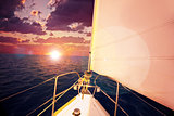 Romantic sunset and sail boat