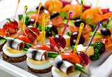 Plate with various seafood and meat canapes