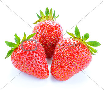 Three Sweet Juicy Strawberries Isolated on White Background. Summer Healthy Food Concept