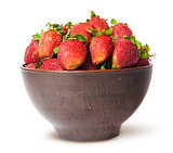 Ripe juicy strawberries in a ceramic bowl