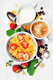 Breakfast with coffee, corn flakes, milk  and berry
