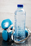 dumbbells and bottle of water