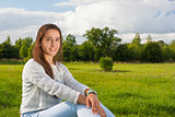 Beautiful teenager on the grass