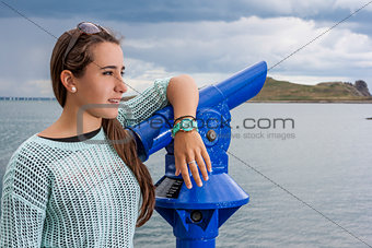 Beautiful teenager at the harbour
