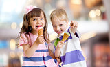 happy kids eating ice cream on nice bokeh background
