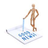 Wooden mannequin writing in scrapbook - Good news