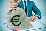 young man in suit with a burlap money bag with the euro sign