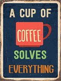 "Retro metal sign "" A cup of coffee solves everything"""