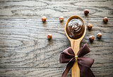 Wooden spoon of chocolate cream with hazelnuts