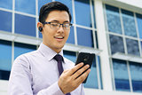 Businessman Talking Video Call On Mobile With Bluetooth Handsfre