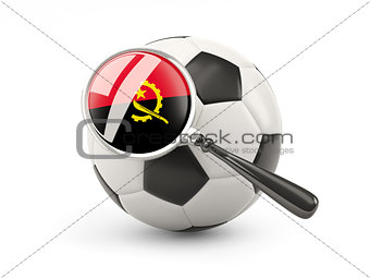 Football with magnified flag of angola
