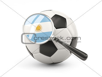 Football with magnified flag of argentina