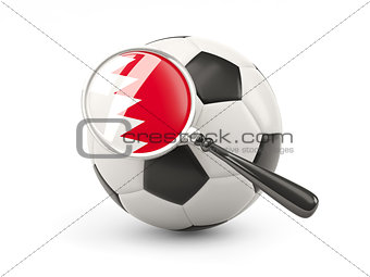 Football with magnified flag of bahrain