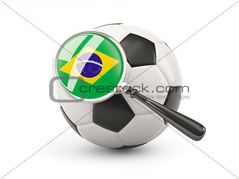 Football with magnified flag of brazil