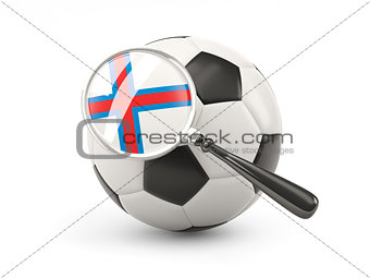 Football with magnified flag of faroe islands
