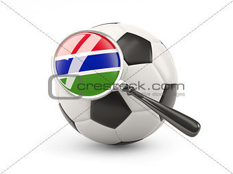 Football with magnified flag of gambia