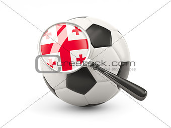 Football with magnified flag of georgia