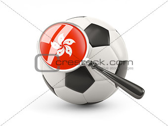 Football with magnified flag of hong kong