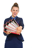 Business woman struggling to carry big files
