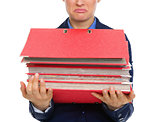 Closeup of upset businesswoman's hands holding stack of folders