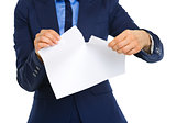 Closeup of businesswoman's hands ripping a piece of paper