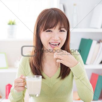 Asian female eating cookies