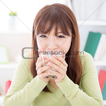 Asian female drinking soymilk