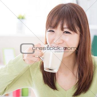 Asian female drinking milk