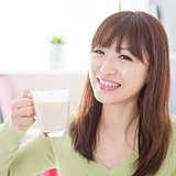Asian female drinking dairy milk