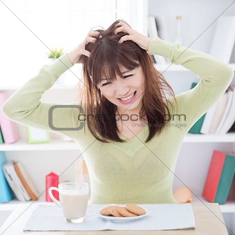 Asian girl feeling bored with her breakfast