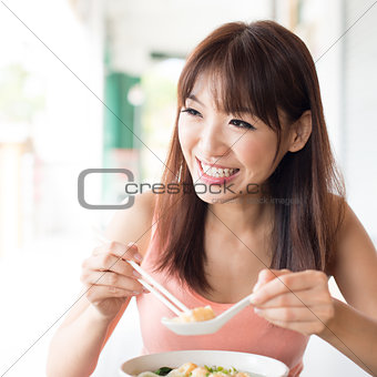 Asian girl eating noodles
