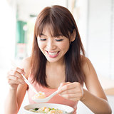 Chinese girl eating noodles